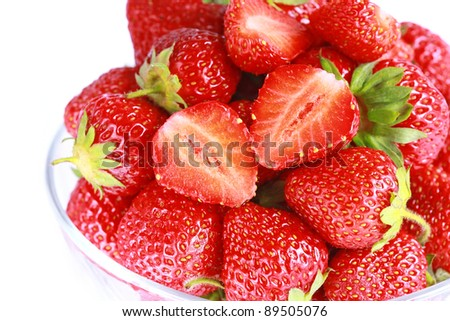 Fresh strawberry in glass bowl on white background isolated