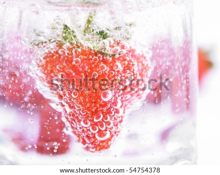 Fresh Strawberry in Mineral water with boobles - stock photo
