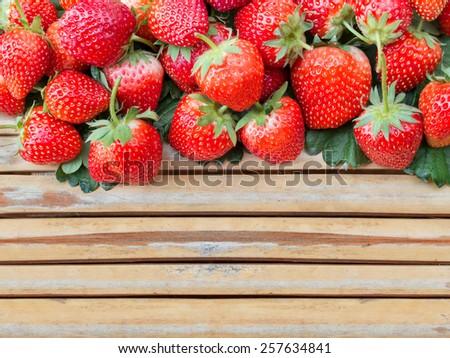 Fresh strawberry on bamboo wood panel - stock photo