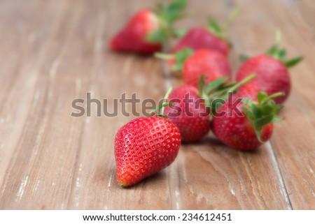 Fresh strawberry  on wood  - stock photo