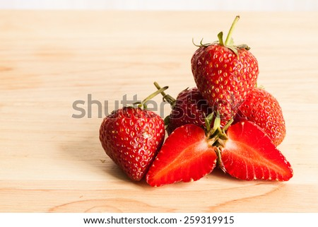 Fresh strawberry on wood. - stock photo