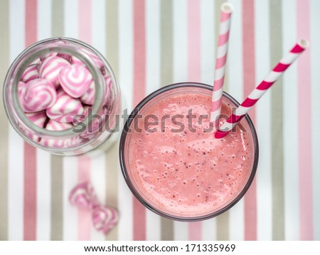 Fresh strawberry smoothie with sweet candies - stock photo