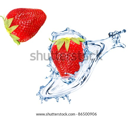 Fresh strawberry splashing into water - stock photo