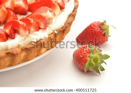 Fresh strawberry tart on white background - stock photo