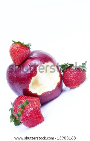 Fresh strawberry with a bitten wet red apple - stock photo