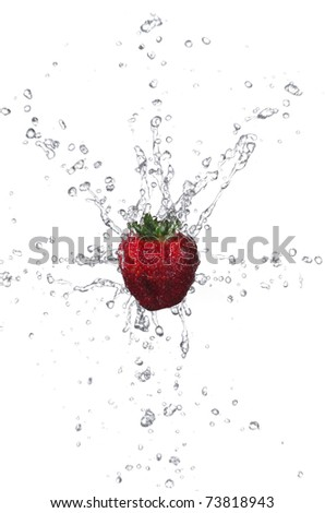 Fresh strawberry with water splashing on white background - stock photo