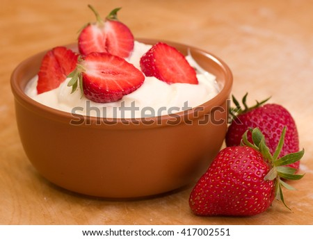 Fresh strawberry with whipped cream - stock photo