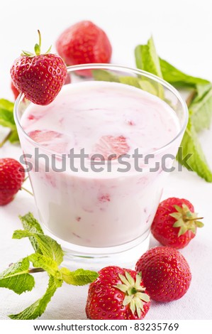 Fresh strawberry yoghurt in glass - stock photo