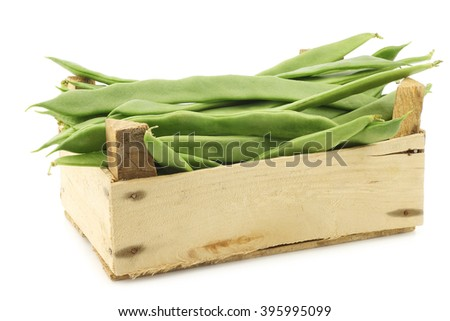 fresh string beans in a wooden crate on a white background - stock photo