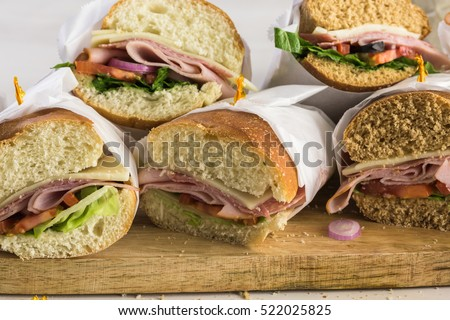 Fresh sub sandwich on white and wheat hoagies.