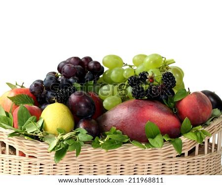 Fresh summer basket fruits - stock photo