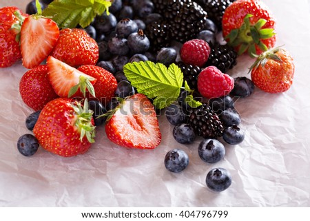 Fresh summer berries  on white background copyspace - stock photo