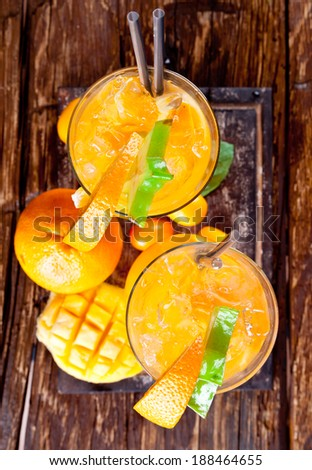 Fresh summer cocktails with exotic fruit, served on wood. Shot from upper view - stock photo