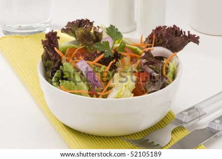 Fresh summer salad in a white bowl. Selective focus.