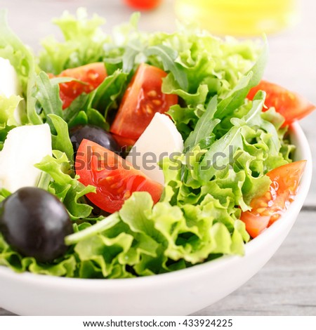 Fresh Summer Vegetable Salad With Arugula Tomatoes Black Olives Lettuce With Mozzarella In