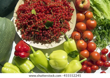 Fresh summer vegetables harvest from garden. Top view on multiple kinds of vegetables on white wooden table.  - stock photo