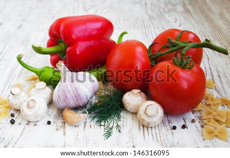 Fresh summer vegetables on a wooden  background