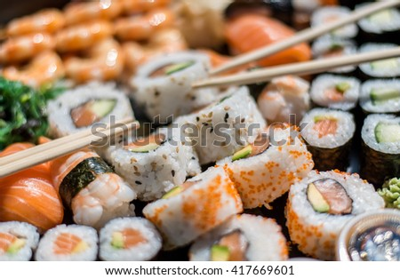 Fresh sushi set as a party food - stock photo