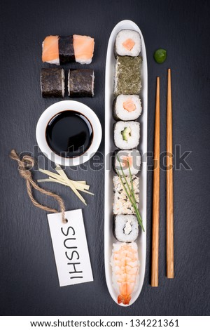 Fresh sushi with label - stock photo