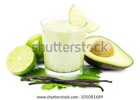 Fresh sweet avocado smoothie with avocado, limes and vanilla beans on a white background - stock photo