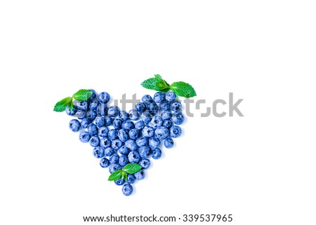 Fresh sweet blueberry fruit and leaf of mint heart shaped. Dessert healthy food. Group of ripe blue juicy organic berries. Raw summer diet. Isolated on white background. - stock photo