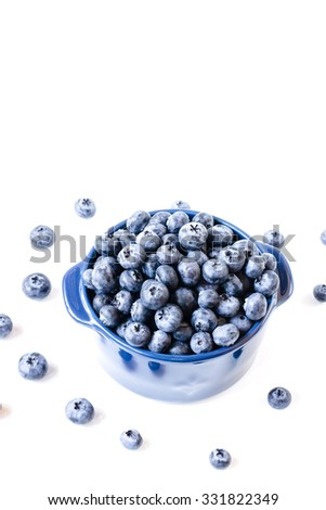 Fresh sweet blueberry fruit in bowl with wooden spoon. Dessert healthy food. Group of ripe blue juicy organic berries. Raw summer diet. Delicious nature vegetarian ingredient. - stock photo