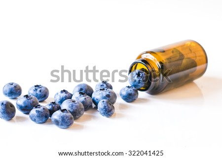 Fresh sweet blueberry fruit  in medical bottle from pills. Dessert healthy food. Group of ripe blue juicy organic berries. Raw summer diet. Delicious nature vegetarian ingredient - stock photo