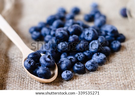 Fresh sweet blueberry fruit in spoon. Dessert healthy food. Group of ripe blue juicy organic berries. Raw summer diet. Delicious nature vegetarian ingredient.