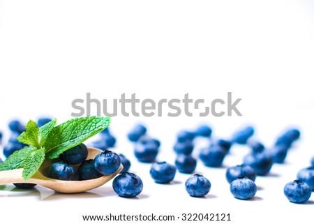 Fresh sweet blueberry juicy fruit. Blueberry juicy dessert, blueberry juicy healthy food. Group of ripe blueberry blue juicy organic berries. Raw blueberry juicy summer diet. Delicious blueberry, mint - stock photo