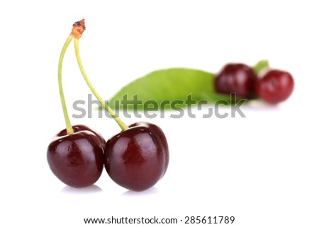Fresh sweet cherries isolated on a white background