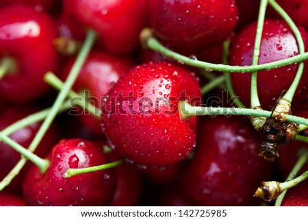Fresh sweet cherries with drops of water. Macro image. - stock photo
