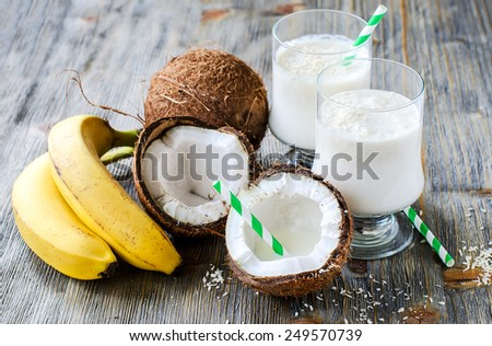 Fresh sweet healthy coconut milk shake with bananas  - stock photo