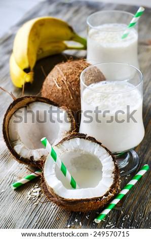 Fresh sweet healthy coconut milk shake with bananas vertical - stock photo