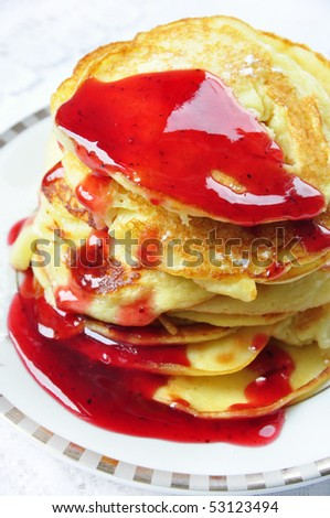fresh sweet homemade pancakes with red sauce - stock photo