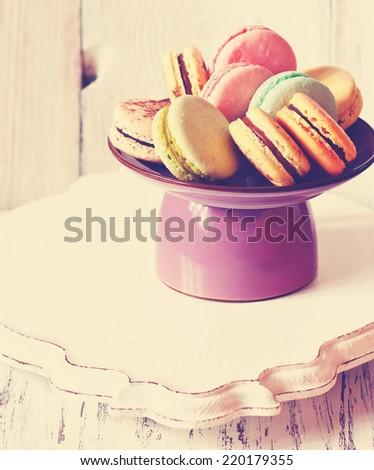 Fresh sweet macarons on a cake stand - stock photo