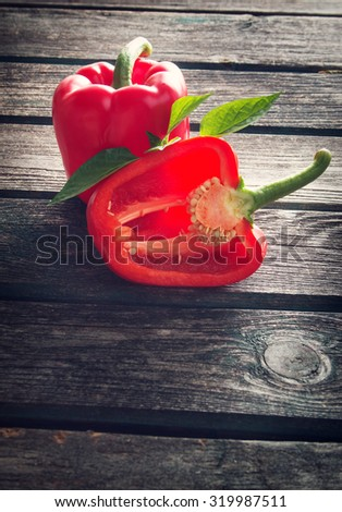 Fresh sweet red pepper on old wooden background - stock photo