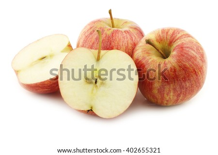 fresh sweet small apples and a cut one on a white background - stock photo