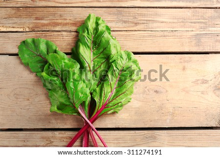 Fresh swiss chard on wooden table, close up - stock photo
