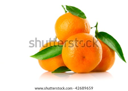 fresh tangerine fruits with green leaves isolated on white background - stock photo