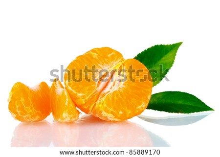 Fresh tangerine with leaves and segments isolated on white - stock photo