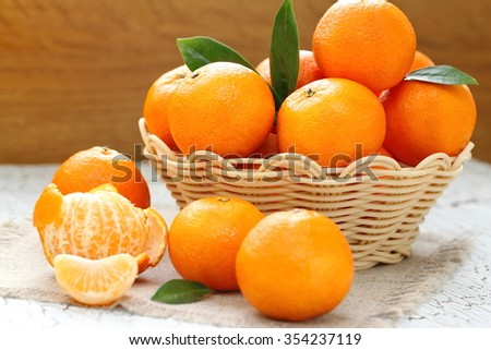 Fresh tangerines in a basket - stock photo