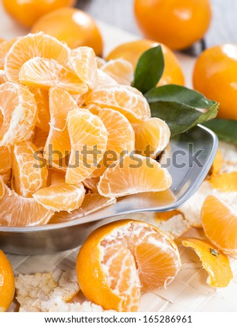 Fresh Tangerines in a bowl (close-up shot) - stock photo