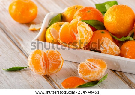 Fresh Tangerines  on  wooden background. Selective focus