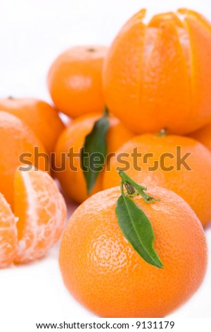 Fresh tangerines with leaf - stock photo