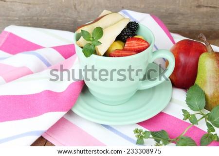 fresh tasty fruit salad on table - stock photo