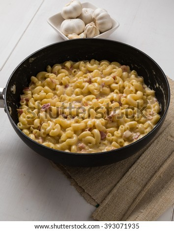 fresh tasty macaroni and cheese in frying pan - stock photo