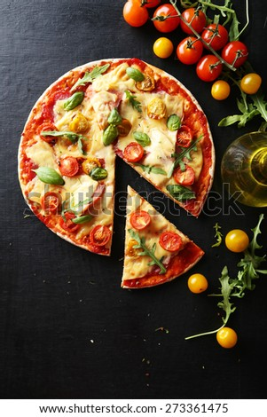 Fresh tasty pizza on black background - stock photo