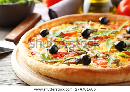 Fresh tasty pizza on grey wooden background - stock photo