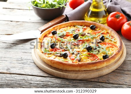 Fresh tasty pizza on grey wooden background
