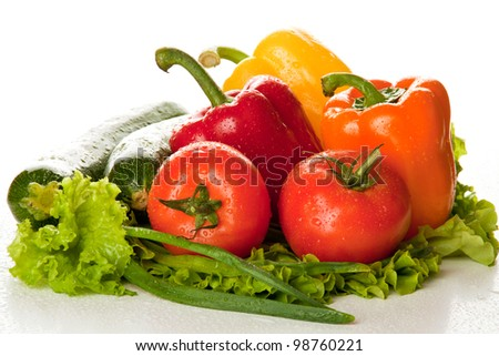 Fresh tasty vegetables with water drops isolated on white background - stock photo